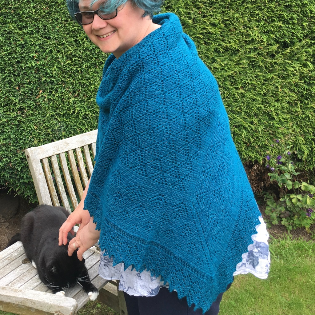 A picture of Elinor Hap Shawl being worn.