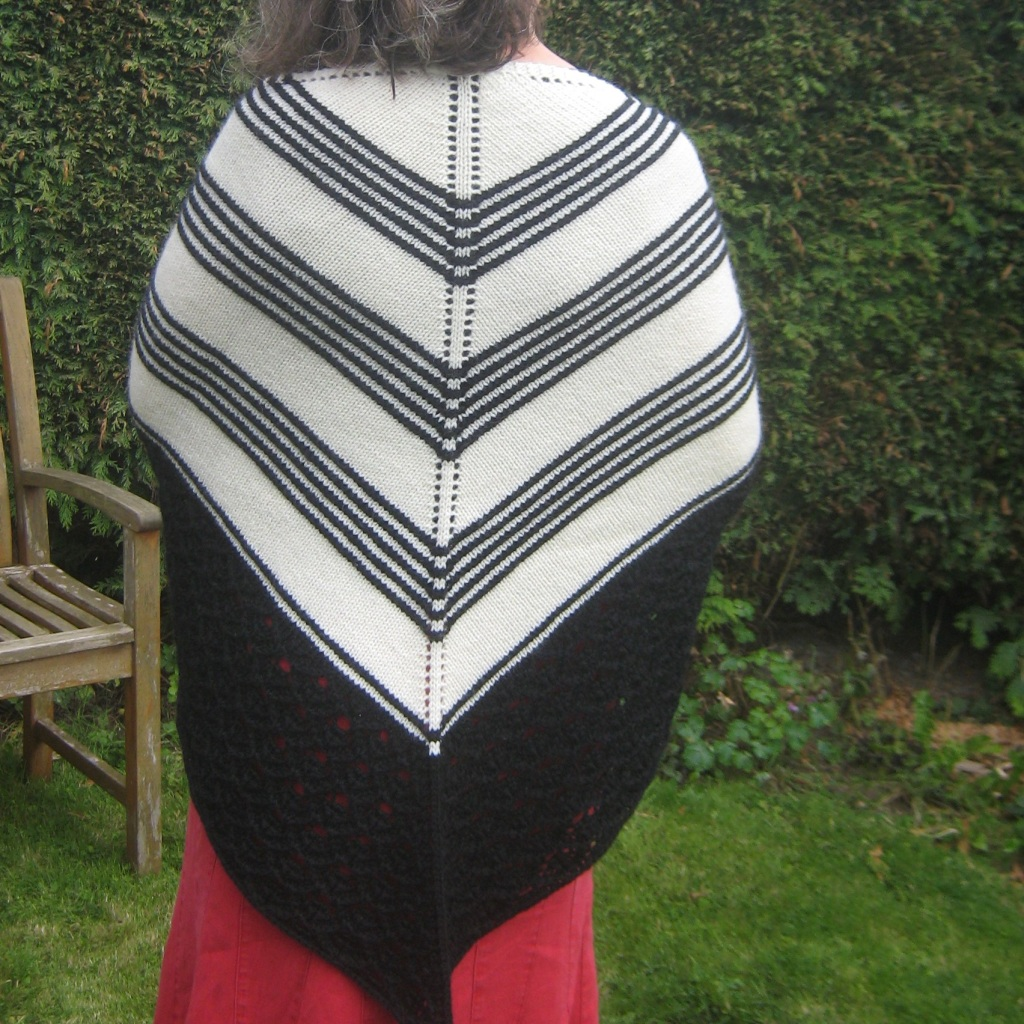 A picture of Codetta Shawl being worn, shown from the back.