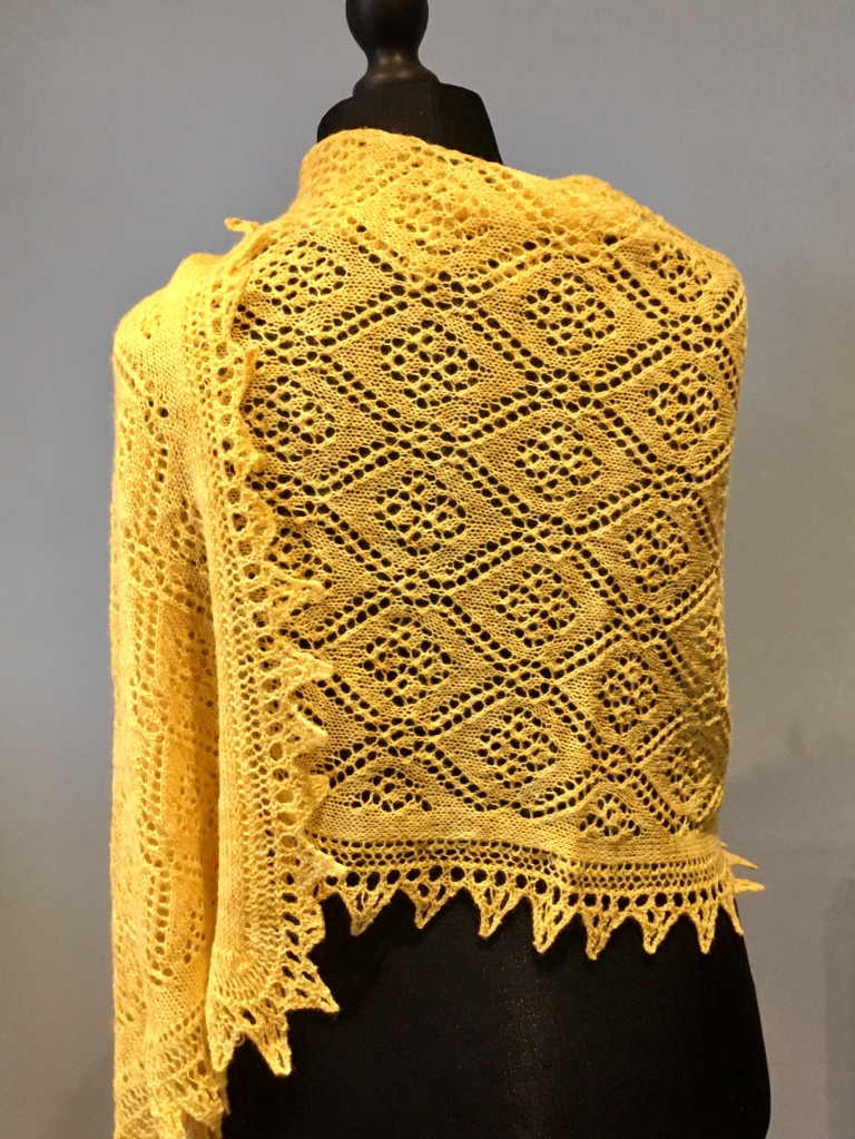 A picture of Helena Rose Stole shown on a mannequin from the back.