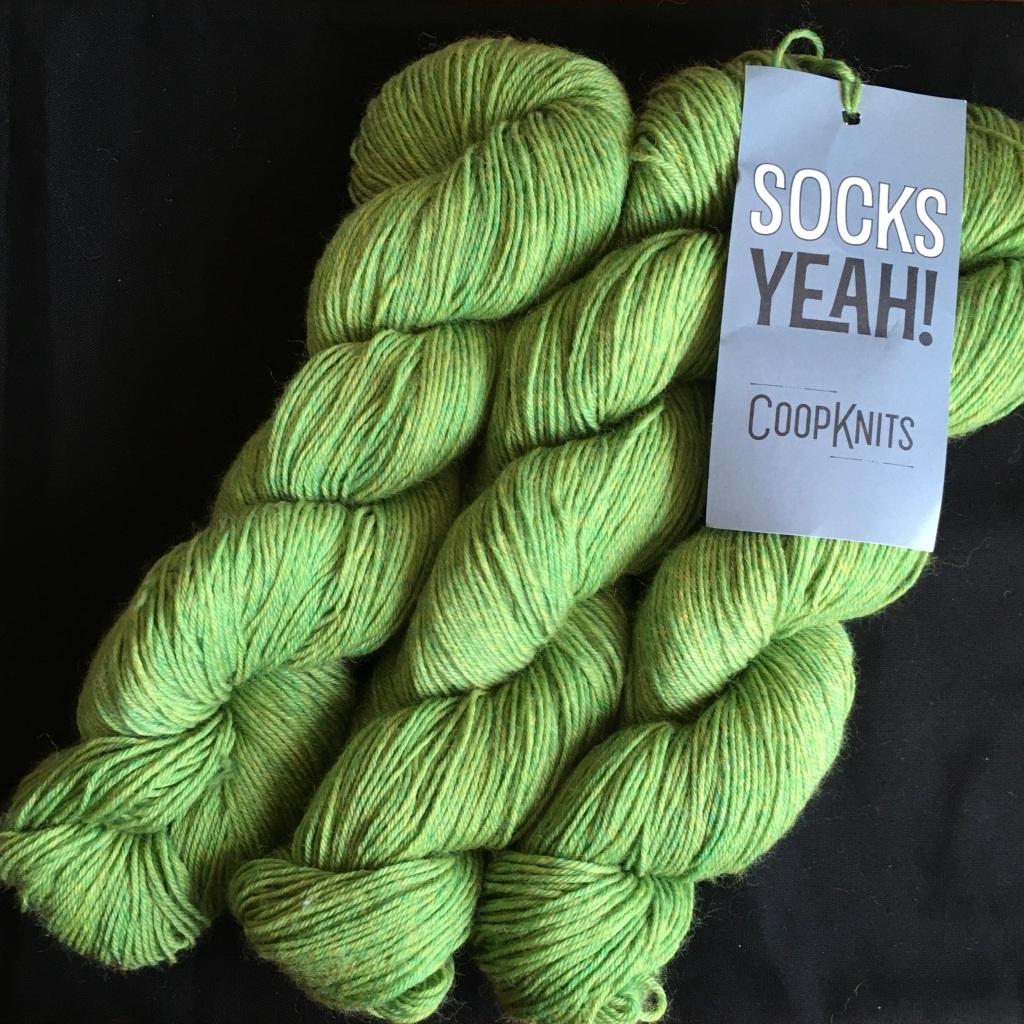 3 skeins of CoopKnits Socks Yeah! in Peridot