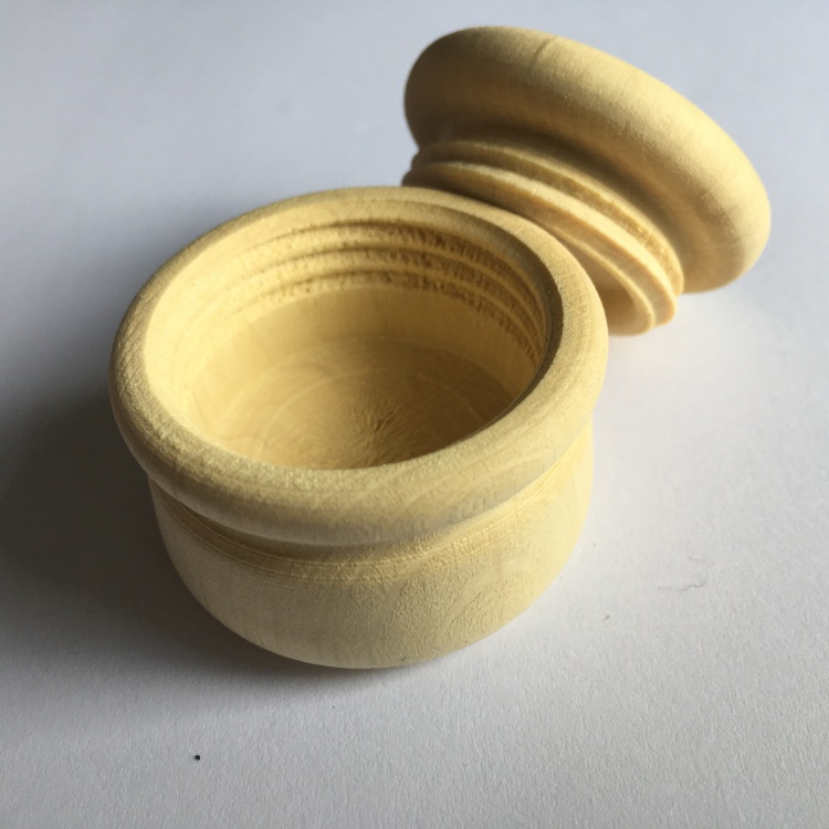 A picture of a large stitch marker pot shown open and empty.
