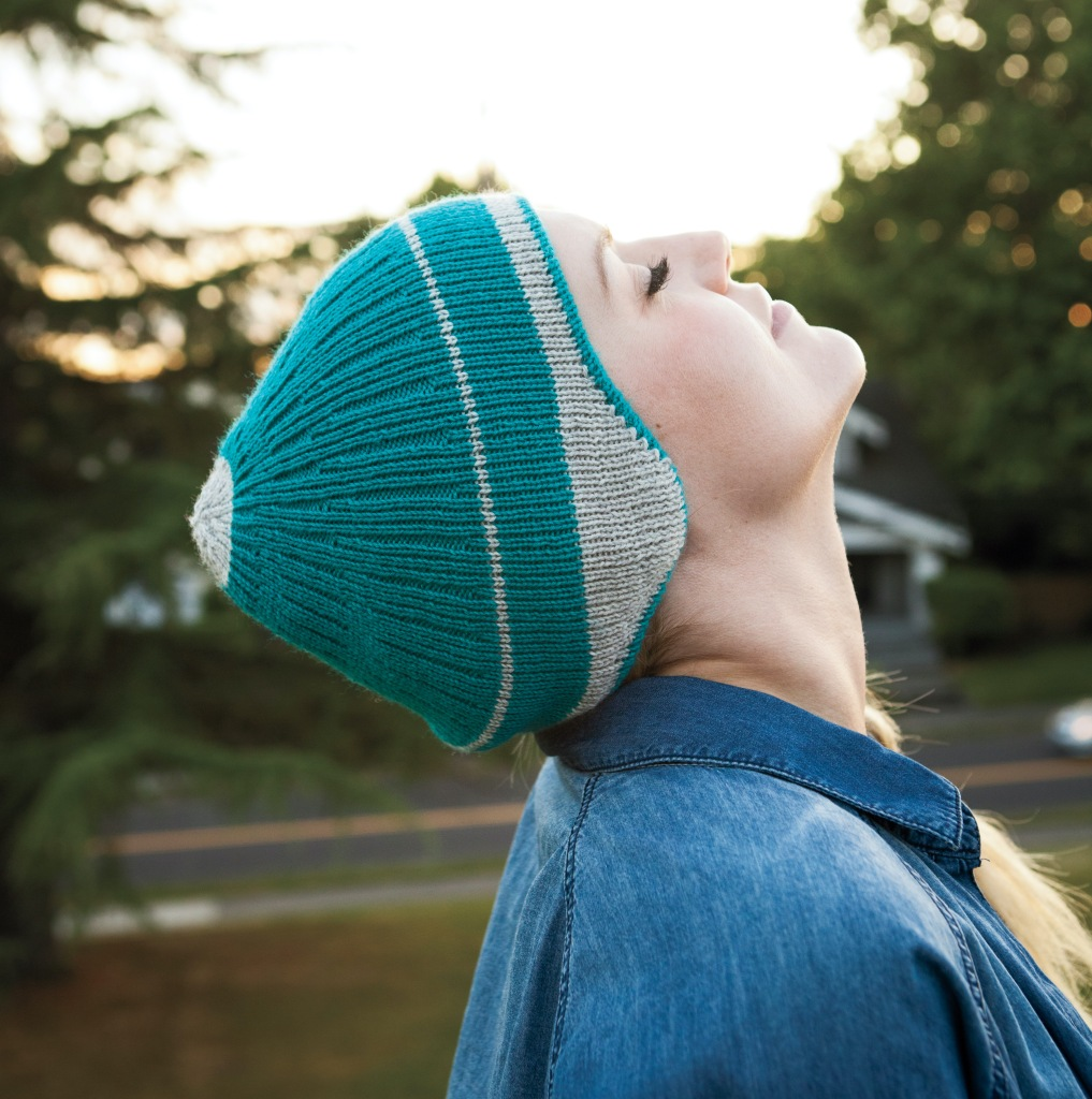 A picture of Now You See Me hat being worn by a model with her head back. Photo copyright to Knit Picks.