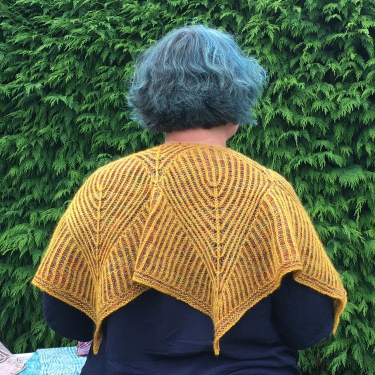 A picture of Beth March Shawl being worn, shown from the back.