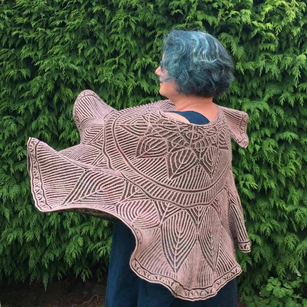 A picture of Meg March Shawl being swirled around the wearer.