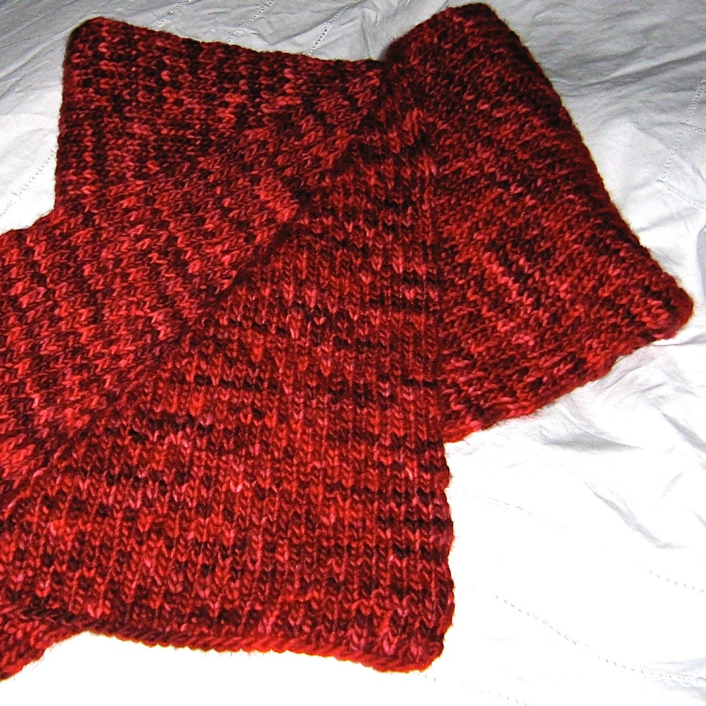 A picture of Soft Syncopated Brioche Scarf folded on a flat surface.