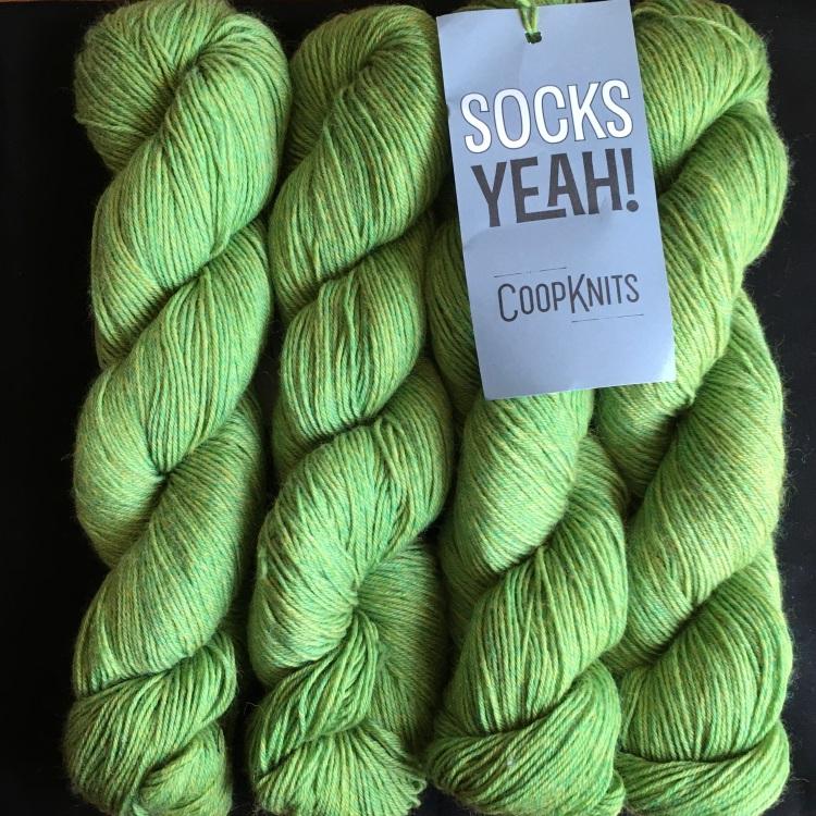 4 skeins of CoopKnits Socks Yeah! in Peridot