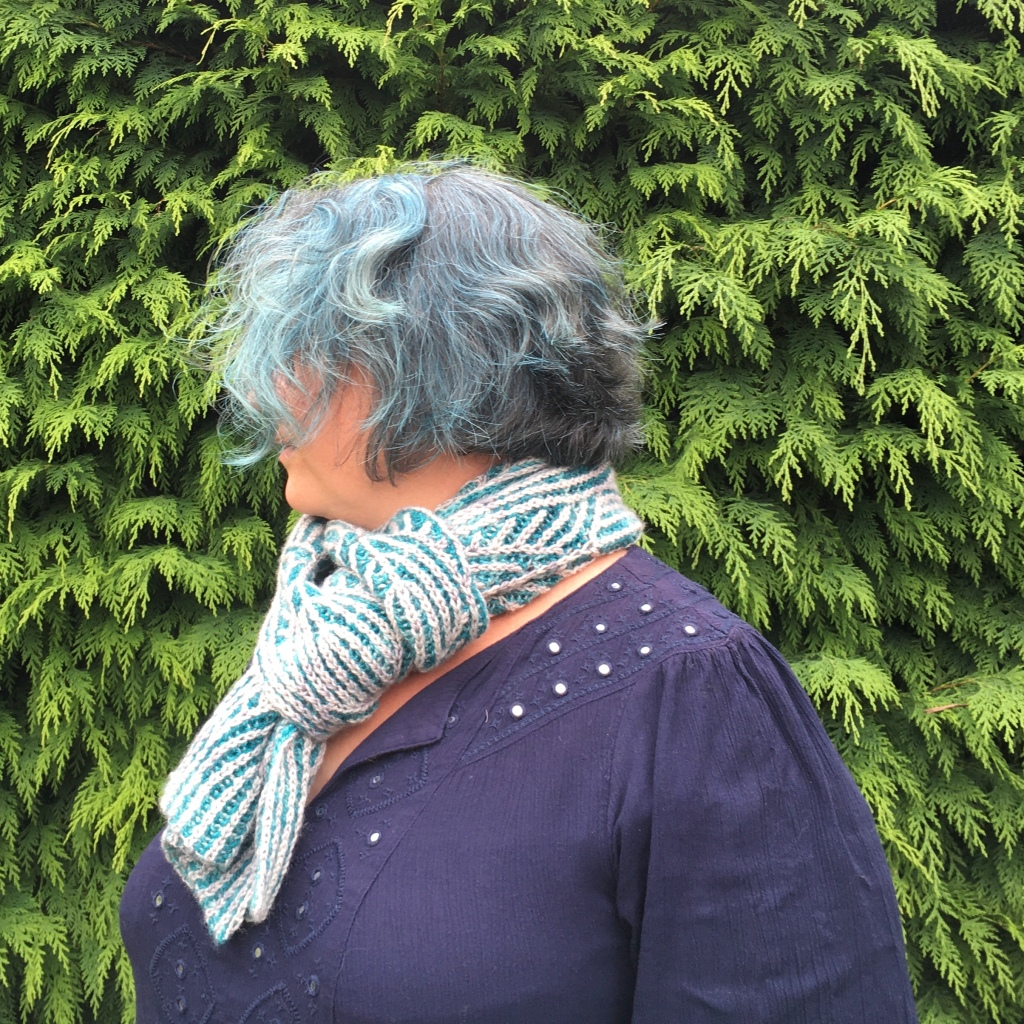 A picture of Jo March Scarf being worn looped around the neck.
