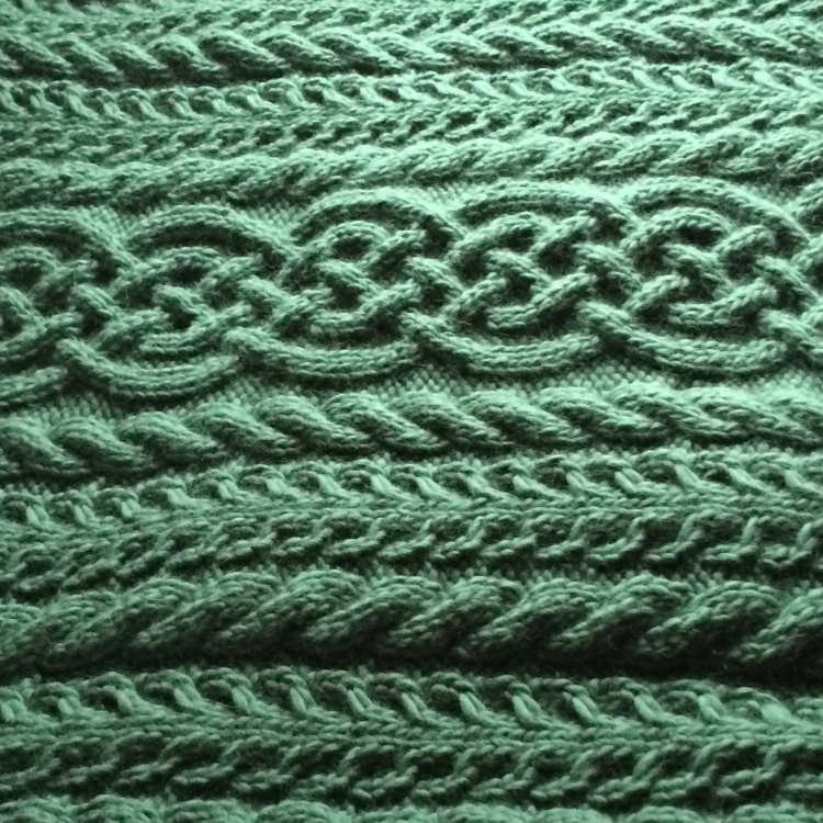 A cabled blanket